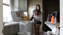 Erin Hubert, 15, does laundry as part of her chores. (Dave Chan for The Globe and Mail)