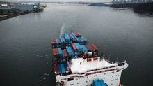 A container ship prepares to pass under the Lions Gate Bridge in Vancouver. (The Globe and Mail)