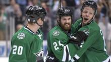 Dallas Stars centre Cody Eakin (20) and defenseman Jordie Benn (24) and right wing Alex Chiasson (12) celebrate the win over the St. Louis Blues at the American Airlines Center. The Stars shut out the Blues 3-0 and clinched the final playoff spot in the western conference. (USA TODAY Sports)