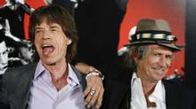 "Rolling Stones band members Mick Jagger (L) and Keith Richards smile during a news conference regarding the documentary film ""Shine A Light"" directed by Martin Scorsese about the Rolling Stones in New York in this March 30, 2008 file photo. (Reuters)"