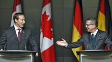 Defence Minister Peter MacKay and his German counterpart, Thomas de Maiziere, hold a news conference at National Defence headquarters in Ottawa on Feb. 14, 2012. (CHRIS WATTIE/Chris Wattie/Reuters)