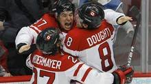 Canada's Sidney Crosby celebrates with teammates Scott Niedermayer and Drew Doughty after scoring the game winning goal against the U.S. during overtime in their men's ice hockey gold medal game at the Vancouver 2010 Winter Olympics Feb, 28, 2010. (TODD KOROL/REUTERS)