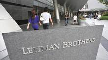 People stroll by Lehman Brothers Holdings Inc.'s head office in Tokyo. (Katsumi Kasahara/Associated Press)