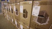In this May 13, 2011 photo, Hewlett Packard computer boxes on display at Micro Center computer store in Santa Clara, Calif. (Paul Sakuma/AP)