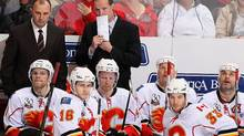 Head coach Brent Sutter and the Calgary Flames bench react after a non goal was reviewed during the second period of the NHL game against the Phoenix Coyotes at Jobing.com Arena on January 28, 2010 in Glendale, Arizona. The Coyotes defeated the Flames 3-2 in an overtime shootout. (Photo by Christian Petersen/Getty Images) (Christian Petersen/2010 Getty Images)