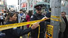 Police close off an area at the Toronto Eaton Centre shopping mall in Toronto, June 2, 2012 (Mark Blinch/Reuters)