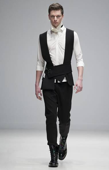 Previously shown alongside its sister label Greta Constantine, Kirk Pickersgill and Stephen Wong presented a men's wear collection that held its ground. Focusing on the idea of armour and protection, the line incorporated boiled wool, heavy knit sweaters and light touches of bondage alongside their signature draped cottons. (Jenna Marie Wakani/Jenna Marie Wakani)