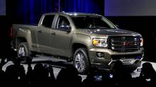 The 2015 GMC Canyon is unveiled during media previews for the North American International Auto Show, Sunday, Jan. 12, 2014, in Detroit. (Paul Sancya/AP Photo)