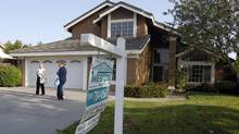 A real estate agent shows a home to prospective buyers last week in Riverside, Calif., (ALEX GALLARDO/REUTERS)