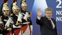 Prime Minister Stephen Harper arrives for the second day of the G20 Summit in Cannes, France, on Nov. 4, 2011. (David Ramos/Getty Images)