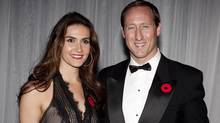 Defence Minister Peter MacKay and Nazanin Afshin-Jam pose for a photo before a fundraiser for military families in Toronto on Nov. 10, 2010. (Darren Calabrese for The Globe and Mail/Darren Calabrese for The Globe and Mail)