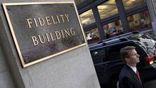 A pedestrian passes the Fidelity headquarters in Boston on May 8, 2007. (JB Reed/Bloomberg News)