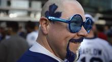 Stephen Stockley from Camrbidge, Ont., dyes his hair Maple Leaf blue and white while gathering with other fans outside in Maple Leaf Square as the Toronto Maple Leafs prepare to meet the Boston Bruins in Game 3 at the Air Canada Centre on May 6 2013. (Fred Lum/The Globe and Mail)