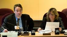 Neil Bouwer, vice-president, policy and programs, for the Canadian Food Inspection Agency, left, and Colleen Barnes, executive director, program, regulatory and trade policy at CFIA, appear as witnesses at agriculture and forestry senate committee in Ottawa on Oct. 4, 2012. (Sean Kilpatrick/THE CANADIAN PRESS)