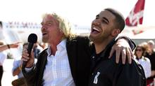 Virgin America Sir Richard Branson and Drake shares a laugh after arriving at Pearson International Airport in Toronto after Virgin launched services in Canada. (DAVE CHAN/The Globe and Mail)