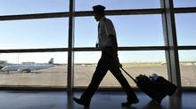 An Air Canada pilot walks to his plane at the International airport in Calgary. If the Air Canada Pilots Association were to obtain a strike mandate, the union has to provide 72-hour notice of any walkout. (TODD KOROL/REUTERS/TODD KOROL/REUTERS)
