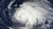 Hurricane Leslie is pictured in this September 6, 2012 NASA handout satellite image as the storm headed east of Bermuda. Leslie was downgraded to a tropical storm September 7, but was expected to regain hurricane strength before passing by Bermuda. (NASA/REUTERS)