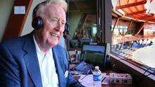Los Angeles Dodgers broadcaster Vin Scully sits in the booth at the ballpark in Glendale, Ariz., for a spring training baseball game on March 25, 2016. (Tom Tingle/The Associated Press)