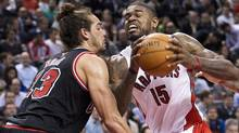 Toronto Raptors forward Amir Johnson, right, drives into Chicago Bulls forward Joakim Noah during first half NBA basketball action in Toronto on Wednesday, January 16, 2013. (Nathan Denette/THE CANADIAN PRESS)