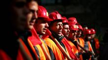Workers chant slogans during a protest in central Athens on Thursday, Dec. 17, 2009 (Petros Giannakouris)