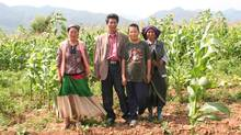 An Zhashi (second left) and his family, standing in the corn field behind his house in Anjia. (Yu Mei/Yu Mei for The Globe and Mail)