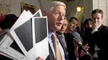 Bob Rae brandishes blacked-out documents about the Afghan-detainee affair on Thursday in Ottawa. (Sean Kilpatrick/Sean Kilpatrick/The Canadian Press)