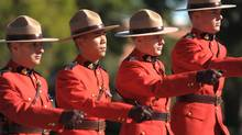 RCMP officers march in Regina on Sunday, September 12, 2010.THE CANADIAN PRESS/Mark Taylor (Mark Taylor/THE CANADIAN PRESS)