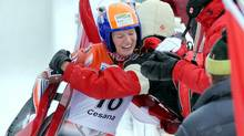 Canada's Alex Gough celebrates in the finish area after winning the bronze medal in the women's single race at the Luge World Championships in Cesana Pariol, Italy, Saturday, Jan. 29, 2011. (Massimo Pinca/AP)
