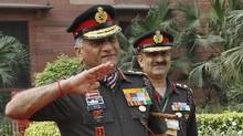 Indian Army chief of staff Vijay Kumar Singh raises his hand to salute his Malaysian counterpart, Datuk Zulkifli, during his ceremonial reception in New Delhi on April 2. (Reuters/Reuters)