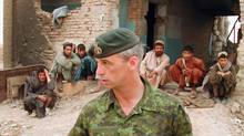 Lt.-Col. Pat Stogran, then commander of Canadian Forces in Afghanistan, is shown near Kandahar in April 2002. Canada's outspoken veterans ombudsman won't be re-appointed by the Conservative government. Sources have told The Canadian Press that retired colonel Pat Stogran, who commanded the country's first battle group in Kandahar in 2002, was notified earlier this week that his term won't be renewed. (Stephen Thorne/The Canadian Press/Stephen Thorne/The Canadian Press)