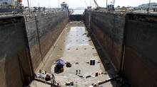 Workers perform periodical maintenance at the Panama Canal. East Coast ports are scrambling to accommodate larger ships in anticipation of increased traffic from the Panama Canal expansion. (STRINGER/REUTERS)