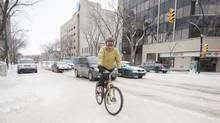 A woman riders her bike down a street in Saskatoon as frigid temperatures grip the city on Jan. 6, 2014. (DAVID STOBBE FOR THE GLOBE AND MAIL)
