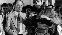 FILE--Former prime minister Pierre Trudeau looks on as Cuban President Fidel Castro gestures during a visit to a Havana housing project in this Jan. 27, 1976 photo. (CP PICTURE ARCHIVE/Fred Chartrand) (FRED CHARTRAND/Canadian Press)