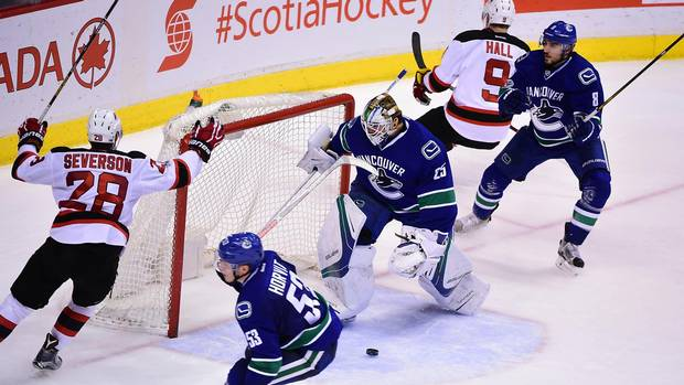 Web-canucks-devils-0115