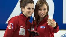 Canada's skip Rachel Homan, right, and lead Lisa Weagle pose for a picture during a practice session at the world women's curling championship in Riga, Latvia on Friday, March 15, 2013. (Andrew Vaughan/THE CANADIAN PRESS)