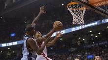 The Raptors' Kyle Lowry drives to the basket with the Grizzlies' Zack Randolph defending in Toronto on Sunday, Feb. 21, 2016. (Chris Young/THE CANADIAN PRESS)