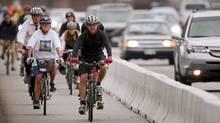 Bicyclists take advantage of Burrard Bridge's new cycling lane in Vancouver Monday July 13, 2009. (JOHN LEHMANN/JOHN LEHMANN/THE GLOBE AND MAIL)