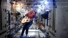 "Canadian astronaut and International Space Station Commander Chris Hadfield performs his zero-gravity version of David Bowie's hit ""Space Oddity"" in this image taken from video, courtesy of Chris Hadfield, NASA and CSA. (NASA/Reuters)"