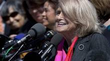 Plaintiff Edith Windsor, of New York, speaks to reporters in Washington, Wednesday, after the Supreme Court heard arguments on the Defence of Marriage Act (DOMA) case. (Carolyn Kaster/Associated Press)