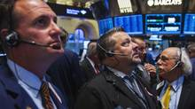 File photo of traders work on the floor of the New York Stock Exchange. (LUCAS JACKSON/REUTERS)