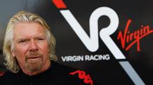 Sir Richard Branson is seen outside the Virgin GP garage before the Bahrain Formula One Grand Prix at the Bahrain International Circuit on March 14, 2010 in Sakir, Bahrain. (Vladimir Rys/VLADIMIR RHYS/BONGARTS/GETTY IMAGES)