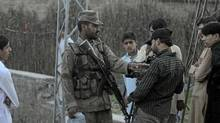 A Pakistani soldier orders to stop filming a media representative near Al-Qaeda chief Osama Bin Laden's final hideout in Abboattabad's Bilal Town vicinity on May 8, 2011 where bin Laden was killed in a US Naval Commandos special operation. The CIA may have focused its war on Al-Qaeda in Pakistan's tribal lands but Osama bin Laden's killing exposes the limits of drone strikes and the need for Islamabad to broaden intelligence in cities. (Asif Hassan/AFP/Getty Images/Asif Hassan/AFP/Getty Images)