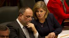 MPP Gilles Bisson, left, and NDP Leader Andrea Horwath chat during Speech from the Throne at Queen's Park in Toronto, February 19, 2013. (Kevin Van Paassen/The Globe and Mail)