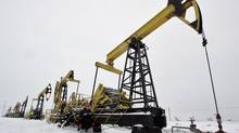 Rosneft pump jacks at the Gremikhinskoye oil field east of Izhevsk near the Ural Mountains. In a $55-billion (U.S.) deal, Russian state oil company Rosneft closed its deal to buy TNK-BP from U.K.-based BP PLC and four tycoons on Thursday. (SERGEI KARPUKHIN/REUTERS)