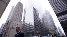 Business people are seen at the intersection of King and Bay Streets in Toronto on Oct. 15, 2014. (Kevin Van Paassen For The Globe and Mail)