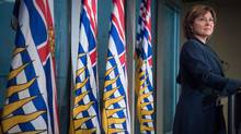 Premier Christy Clark used voicemail to apologize to NDP Leader John Horgan, who, in turn, said he was no hurry to make amends over what he called 'just the weirdest thing in the world.' (DARRYL DYCK/THE CANADIAN PRESS)
