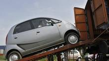 A Tata Motors Nano car is loaded onto a goods train for shipment at Sanand railway station in the western Indian state of Gujarat September 1, 2011. (AMIT DAVE/REUTERS)