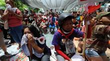 File photo taken on May 19, 2010, shows Thai 'Red Shirt' anti-government protesters in tears as their leaders announce their surrender in downtown Bangkok. (PORNCHAI KITTIWONGSAKUL/PORNCHAI KITTIWONGSAKUL/AFP/GETTY IMAGES)