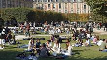 Parisians and tourists enjoy the weather at Place des Vosges in downtown Paris, Sept. 28, 2008. (© Charles Platiau / Reuters/Charles Platiau / Reuters)