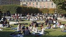 Parisians and tourists enjoy the weather at Place des Vosges in downtown Paris, Sept. 28, 2008. (© Charles Platiau / Reuters/Charles Platiau / Reuters)